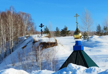 decorates: Rustic church in winter and summer decorates rural landscape