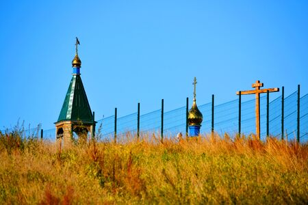 Rustic church in winter and summer decorates rural landscape