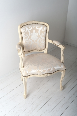 chair with luxurious upholstery in plain white interior photo