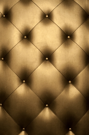brown leather sofa: Luxury golden leather close-up background Stock Photo