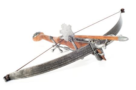 Retro stylized wooden crossbow on white background photo