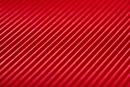 dynamical: bright red with white diagonal stripes paper texture close-up background