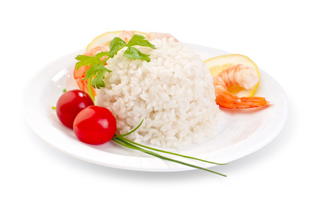 low cal: rice with vegetables and king prawns close-up isolated on white background healthy diet meal example