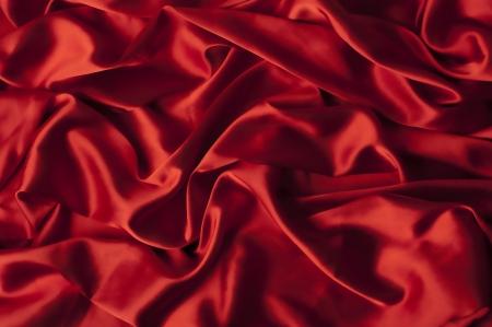 carmine: carmine sfondo di seta close-up con superficie effetto di sfocatura