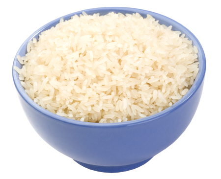 boiled long grain rice in lilac bowl close-up isolated on white background photo