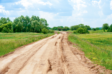 Country road on summer landscape background photo