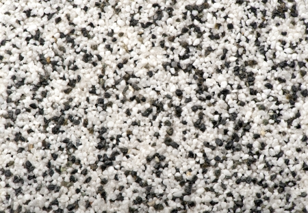 black with white natural marble chip plaster close-up background photo