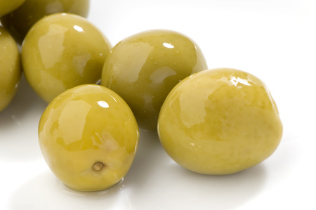 Green olives close-up on white background