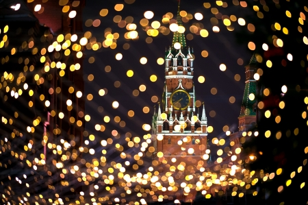 Christmas night Moscow atmosphere with Kremlin Spassky Tower in center holiday background