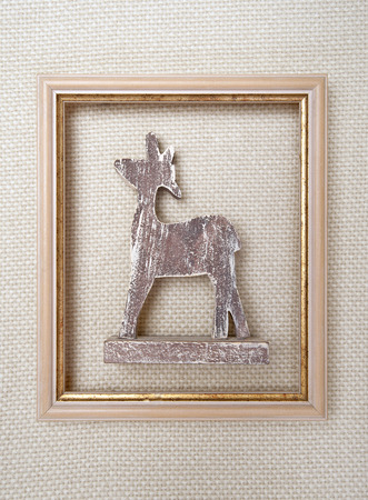 Christmas framed picture with reindeer on wool plaid  background photo
