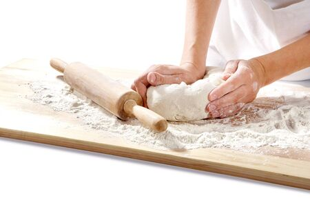 Hands kneading dough on board isolated on white background 版權商用圖片