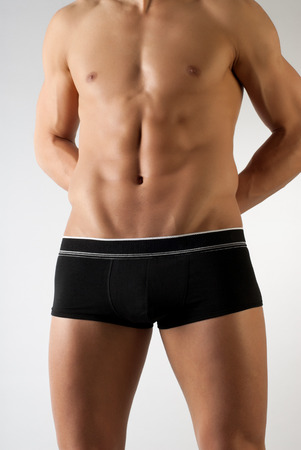 buff: attractive male body with black underwear on neutral background