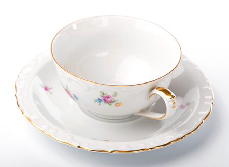 vintage tea pair cup and saucer on white background