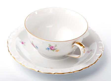 Vintage Tee Paar Tasse und Untertasse auf weißem Hintergrund