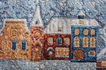gobelin fragment zimowy krajobraz miasta domy pod śniegiem zbliżenie europa sztuka tło
