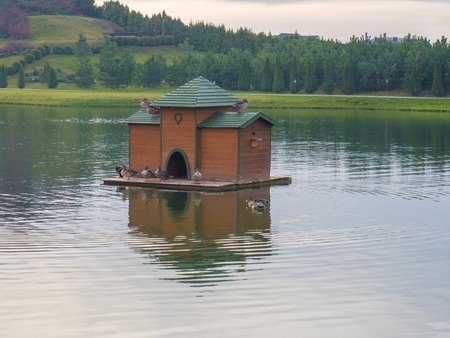 People built a big house for birds in the lake, so they did not freeze in the cold Reklamní fotografie