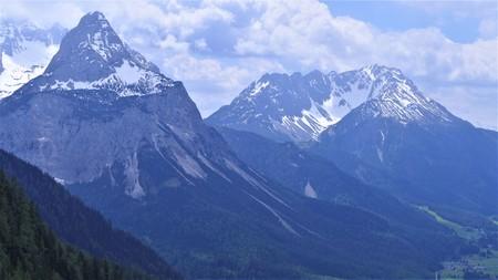 Snowy peaks of the Alpine mountains Stock Photo