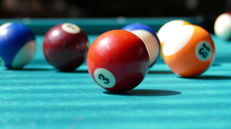 Green billiard table with multi-colored balls