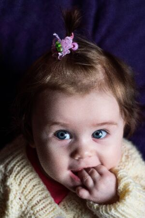 The baby fascinates us with her look and smile