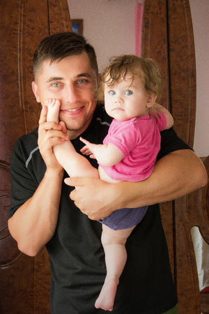 Happy Ukrainian family, father with a fragile girl hugged and admired one another