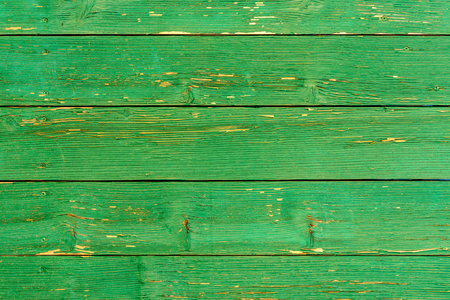 Amazingly beautiful old texture of a green wooden wall with cracked paint