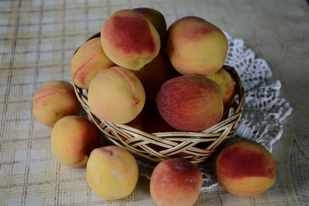 Fresh fragrant and sweet peaches in the basket