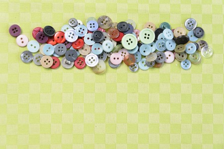 Colored small buttons on a green background Stockfoto