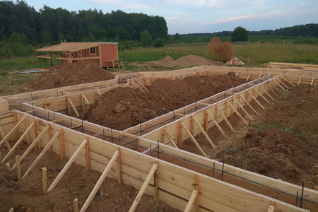 Wooden formwork concrete strip foundation for a cottage Stock Photo