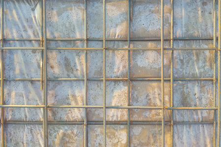 Abstract background of iron armature ready for concreting Metal armature in reinforced concrete structures close-up 2018