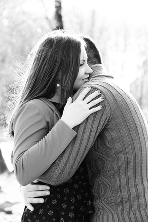 Happy woman hugs her husband on Valentine's day 2018