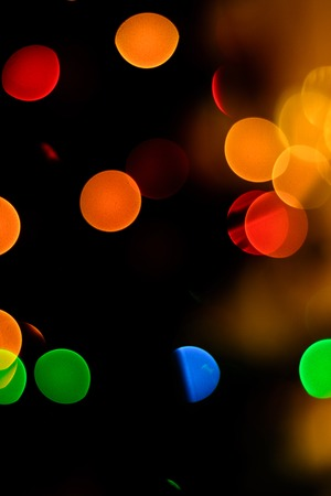 bokeh of blue, green and yellow on a black background 2018