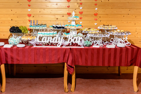 Sweet gourmet buffet table at the wedding in blue tones 2019
