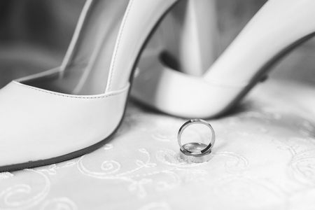 bridal wedding shoes and rings on a white background 2019