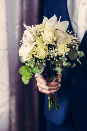 wedding rings lie and beautiful bouquet as bridal accessories 2019