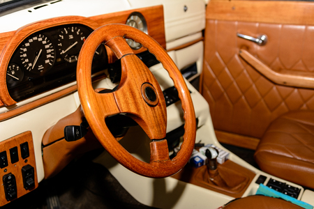 interior of the car is a brown color and leather 2019