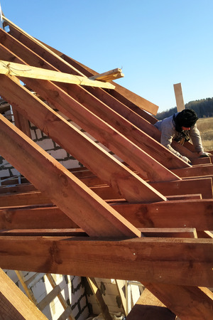 Layout and installation of roof rafters on a new commercial residential construction project by framing contractors 2019