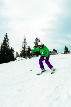 A man in a professional outfit rushes from the mountain skiing in the Ukrainian mountains
