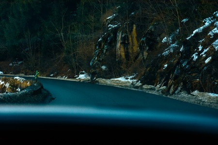 View from the first person from the car interior to the serpentine highway in the mountainous area Reklamní fotografie