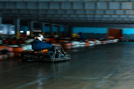 Dynamic karting competition at speed with blurry motion on an equipped racecourse Фото со стока - 122879277