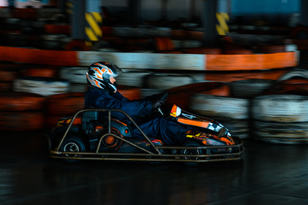 Dynamic karting competition at speed with blurry motion on an equipped racecourse
