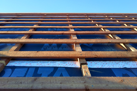Preparation of roof roof before installation of sheets of metal tiles with insulation, waterproofing with the help of film, boards and bars 2019