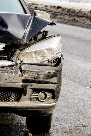Broken car headlight on a black car, close-up, repair and replacement. 2019