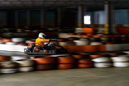 Dynamic karting competition at speed with blurry motion on an equipped racecourse 2019 Stockfoto