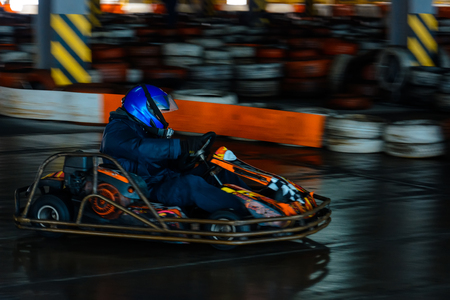 Dynamic karting competition at speed with blurry motion on an equipped racecourse 2019