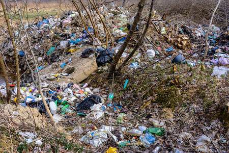 Illegal garbage in spring forest, ecological catastrophe on a large scale in underdeveloped countries. 2019 Stok Fotoğraf