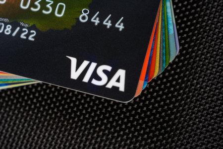 Lviv, Ukraine - 26 April 2019 : Close-up of Visa credit cards placed on a dark background 2020 Редакционное