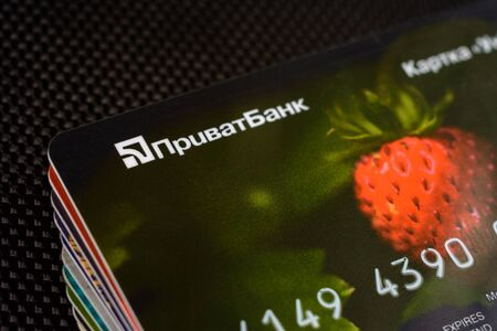 Lviv, Ukraine - 26 April 2019 : Stack of colorful credit cards of the Ukrainian bank titled PrivatBank 2020 Редакционное