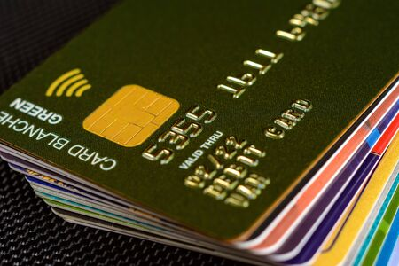 Close-up credit card where the chip is clearly visible on a black background.