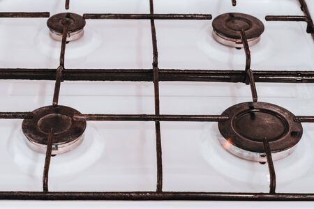 On the white gas stove are four comforters, of which the natural gas boils. 2019