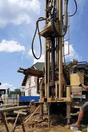Well drilling on the water, the installation is in the car, the drilling process is close-up. 2019 Stock Photo